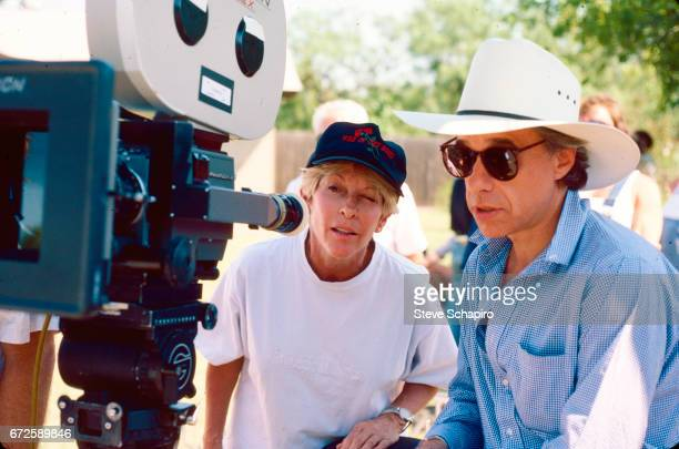 View of American film producer Polly Platt and director Peter Bogdanovitch on the set of an unspecified film late 1980s or early 1990s