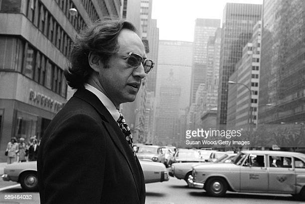 View of American futurist and author Alvin Toffler as he crosses Park Avenue New York New York May 1974 The Pan Am building is visible in the...