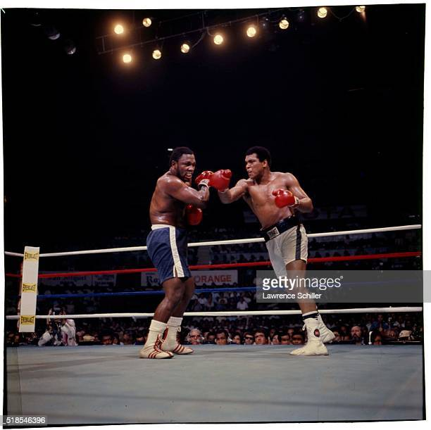View of American Heavywight boxers Joe Frazier and Muhammad Ali as they fight in the ring at Araneta Coliseum, Quezon City, Philippines, October 2,...