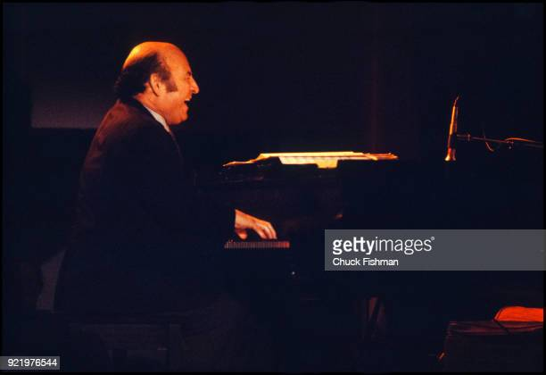 View of American Jazz promotor and producer George Wein plays piano at the New Orleans Jazz Festival New Orleans Louisiana April 1980