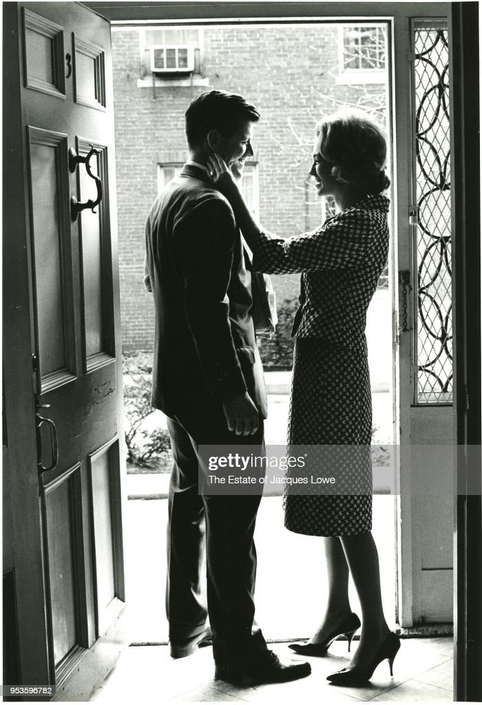 View of American lawyer (and future US Senator) Ted Kennedy (1932 - 2009) and his wife, Joan Bennett Kennedy, as they smile at one another in the doorway of their home, 1960s.