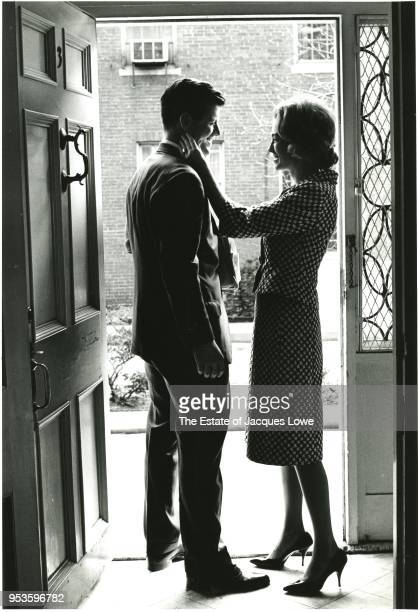 View of American lawyer Ted Kennedy and his wife Joan Bennett Kennedy as they smile at one another in the doorway of their home 1960s