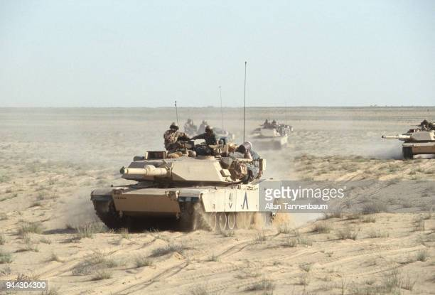 View of American M1A1 Abrams tanks as they cross the desert during the Gulf War Iraq 1991