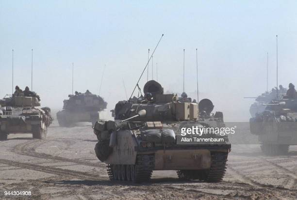 View of American M3 Bradley Fighting Vehicles as they cross the desert during the Gulf War Iraq March 28 1991