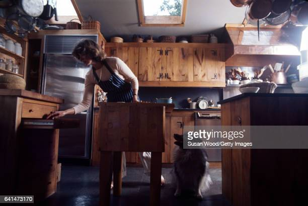 View of American media mogul and businesswoman Martha Stewart in a blue striped apron as she works in her kitchen Westport Connecticut August 1976