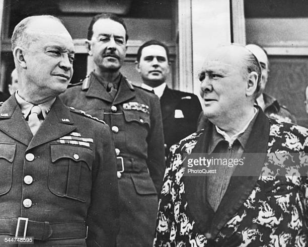 View of American military commander and later US President General Dwight D Eisenhower and British Prime Minister Sir Winston Churchill dressed in a...