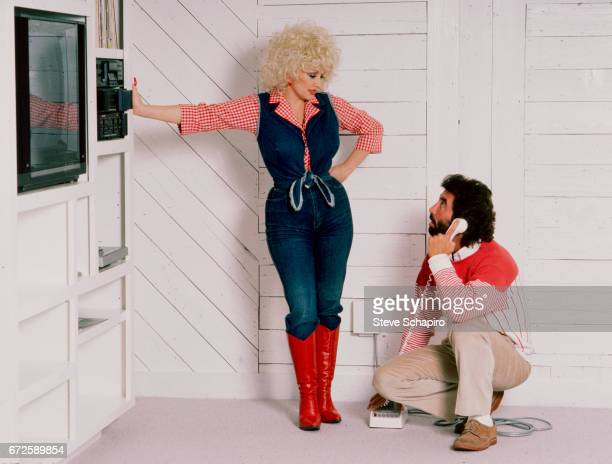 View of American musician and actress Dolly Parton and her agent Sandy Gallin at the latter's home Los Angeles California 1984