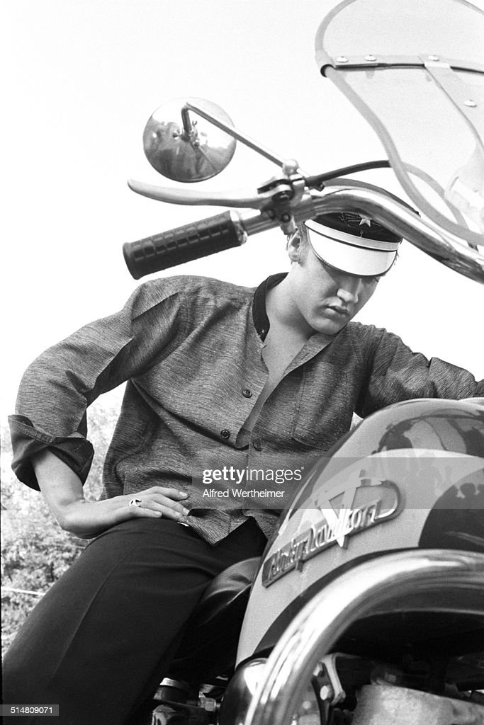 Alfred Wertheimer/Getty Images) View of American musician (and actor) Elvis Presley (1935 - 1977) as he sits his Harley-Davidson motorcyle, Memphis, Tennessee, July 4, 1956.