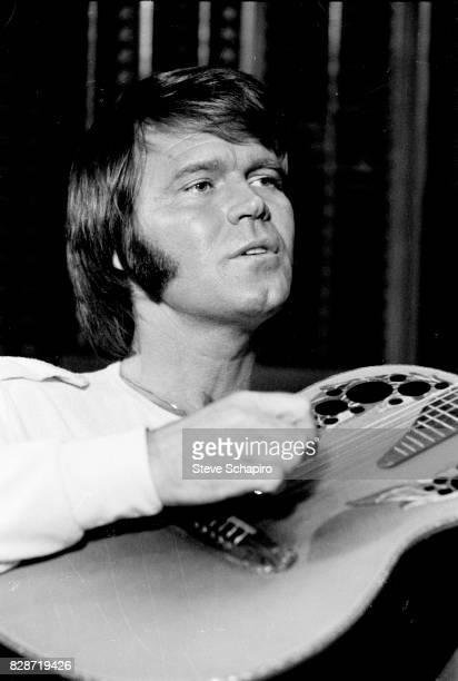 View of American musician Glen Campbell as he plays guitar Los Angeles California 1978