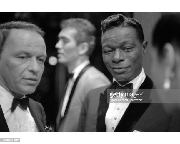 View of American musicians Frank Sinatra and Nat King Cole as they attend the 16th Primetime Emmy Awards ceremony held at the Hollywood Palladium Los...