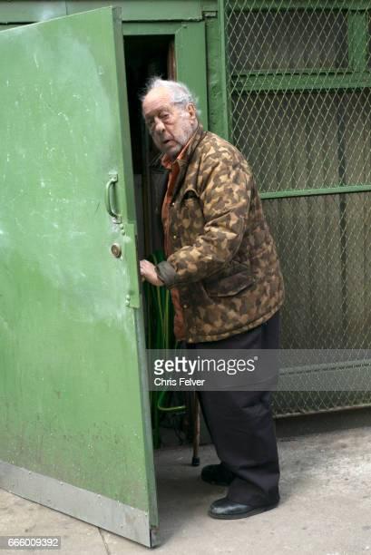 View of American photographer and filmmaker Robert Frank as he opens a door New York New York March 2017