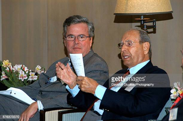 View of American politician and former Florida Governor Jeb Bush and businessman and Amway cofounder Richard DeVos as he moderates a panel discussion...