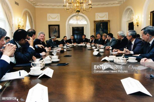 View of American politician US President Clinton and Russian President Boris Yeltsin along with advisors translators and various business executives...