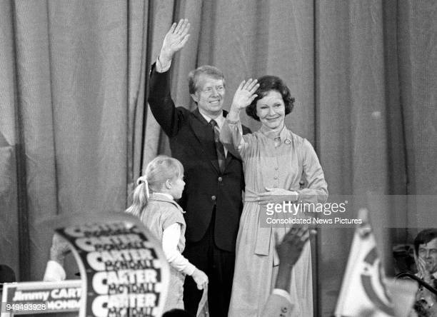 View of American politician US PresidentElect Jimmy Carter future First Lady Rosalynn Carter and their daughter Amy as they wave from the stage at...