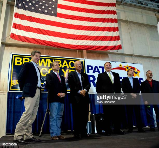 View of American politicians all Republican party members from Kansas as they pose together on stage during a rally in support of reelection...