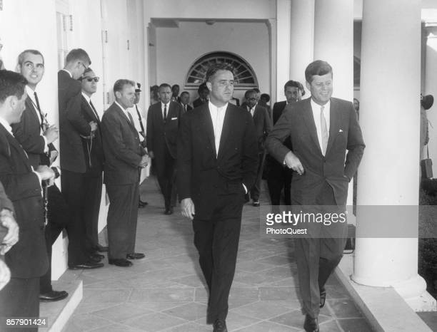 View of American politicians Director of the Peace Corps Sargent Shriver and President John F Kennedy as they greet the inaugural group of Peace...
