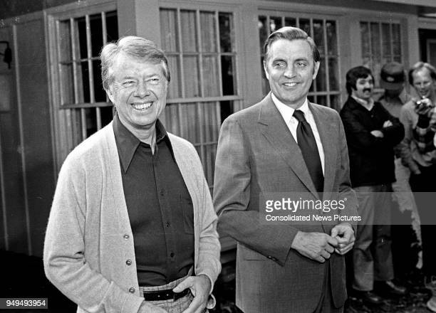 View of American politicians US President-Elect Jimmy Carter and US Vice President-Elect Walter Mondale as they share a laugh prior to a press...