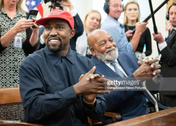 View of American rapper and producer Kanye West and retired professional football player Jim Brown in the White House's Oval Office Washington DC...