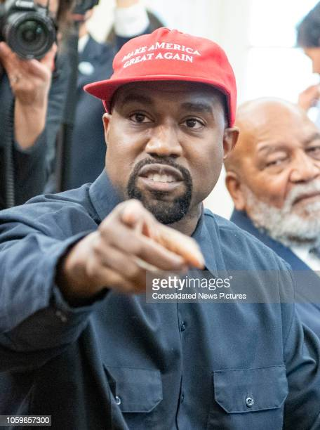 View of American rapper and producer Kanye West as he points towards the camera in the White House's Oval Office Washington DC October 11 2018 He...