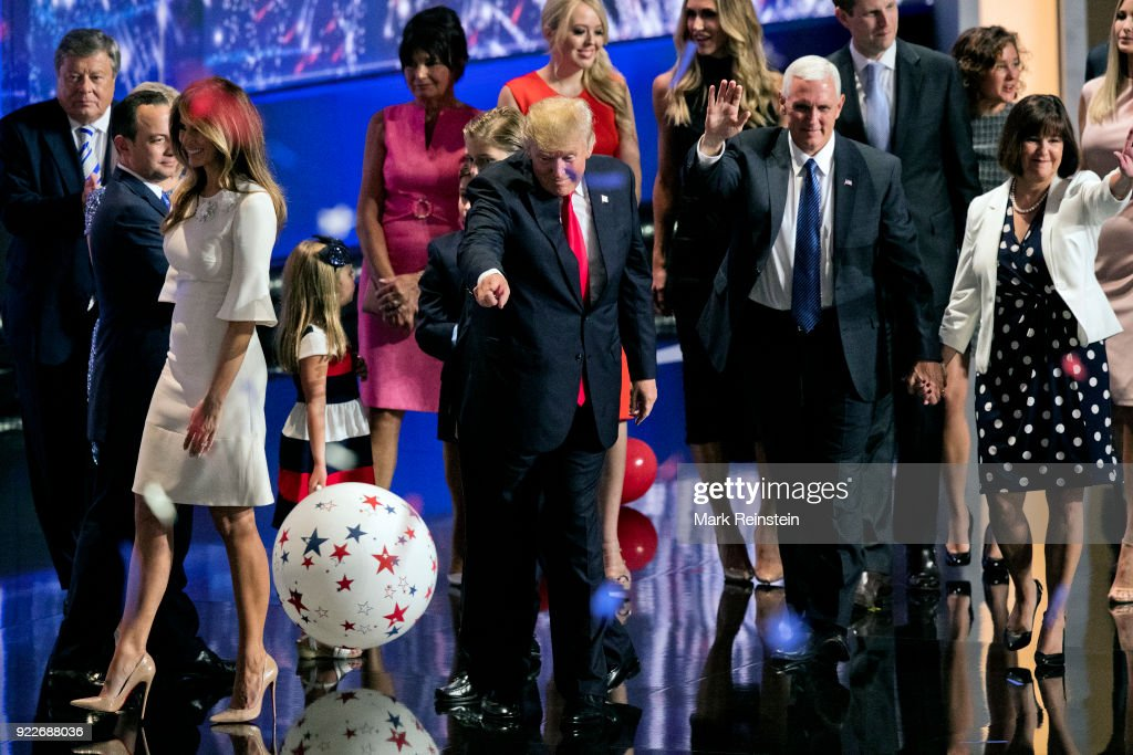 View of American real estate developer and presidential candidate Donald Trump (center left) and his running mate, Indiana Governor and vice-presidential candidate Mike Pence (center right), along with their families, during the Republican National Convention at Quicken Loans Arena, Cleveland, Ohio, July 21, 2016. Among those also pictured are, Melania Trump's father Viktor Knavs (left), Republican National Committee chairman Reince Priebus (second left), Melania Trump (in white) and her mother, Amalija Knavs (in pink), Tiffany Trump (in red), Lara (behind Pence's raised hand) and Eric Trump, Charlotte Pence, Karen Pence (in polka-dot dress), and Ivanka Trump.