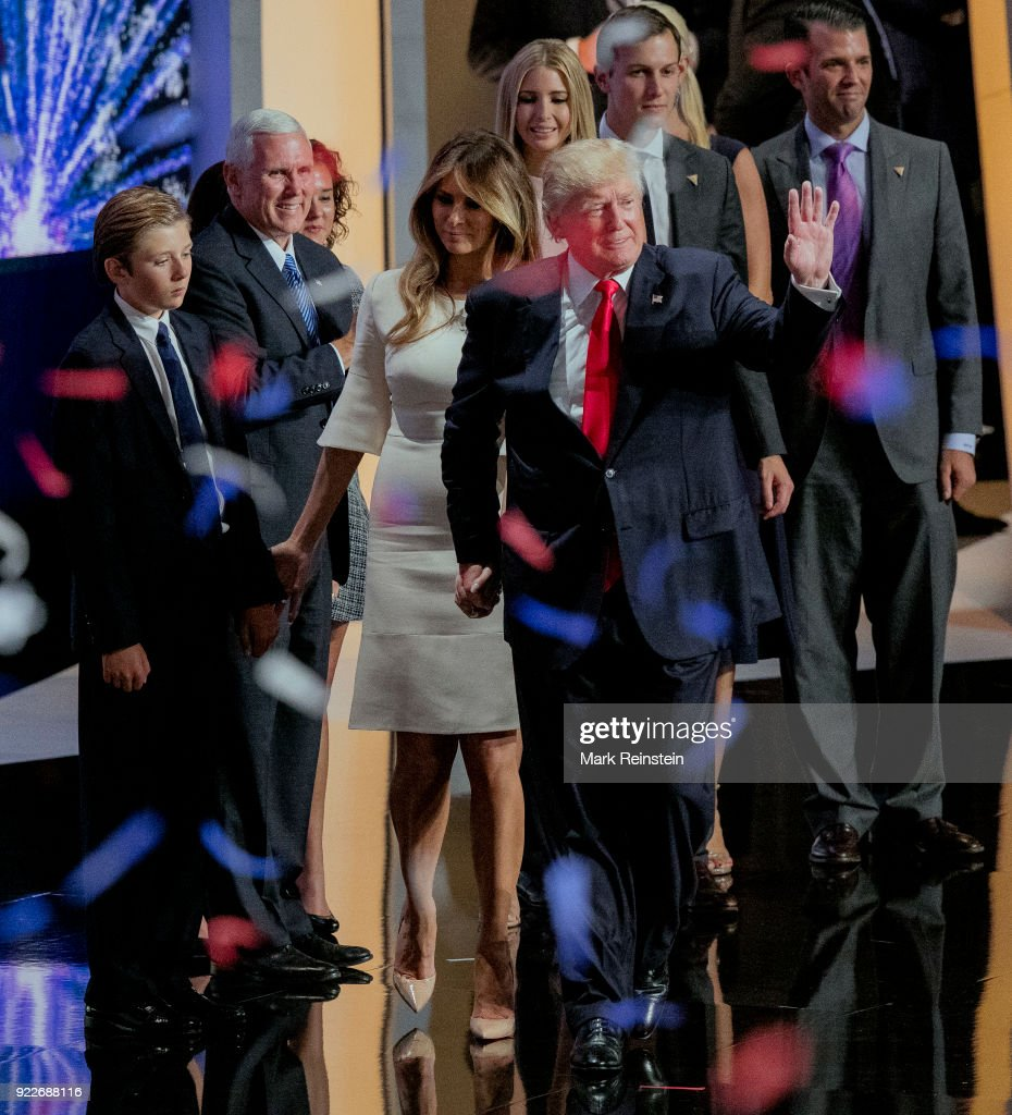 View of American real estate developer and presidential candidate Donald Trump (right), his wife, former model Melania Trump (in white), and his running mate, Indiana Governor and vice-presidential candidate Mike Pence (second left) along with their families, during the Republican National Convention at Quicken Loans Arena, Cleveland, Ohio, July 21, 2016. Pictures are, from left, Barron Trump, Pence, Charlotte Pence, Ivanka Trump, Jared Kushner, Vanessa Trump, and Donald Trump Jr.
