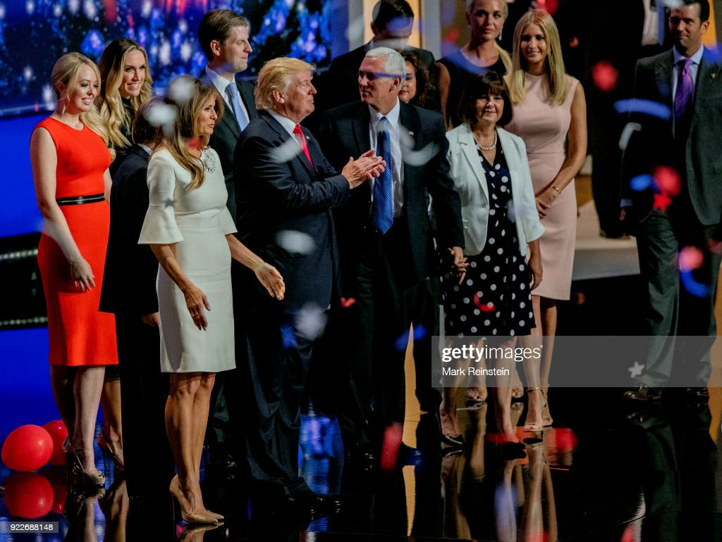 View of American real estate developer and presidential candidate Donald Trump (center left) and his running mate, Indiana Governor and vice-presidential candidate Mike Pence (center right), along with their families, during the Republican National Convention at Quicken Loans Arena, Cleveland, Ohio, July 21, 2016. Pictured behind them are, Melania Trump (fore left), and rear from left, Tiffany Trump (in red), Lara and Eric Trump, Jared Kushner, Charlotte Pence, Karen Pence (in polka-dot dress), Vanessa Trump, Ivanka Trump (in pink), and Donald Trump Jr.