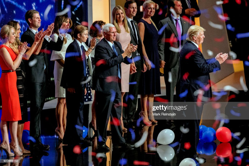 View of American real estate developer and presidential candidate Donald Trump (right) and his running mate, Indiana Governor and vice-presidential candidate Mike Pence (center), along with their families, during the Republican National Convention at Quicken Loans Arena, Cleveland, Ohio, July 21, 2016. Pictured behind them are, from left, Tiffany Trump (in red), Lara and Eric Trump, Melania Trump (in white), Barron Trump, Karen Pence (in polka-dot dress), Charlotte Pence, and couples, Ivanka Trump & Jared Kushner and Vanessa Trump & Donald Trump Jr.