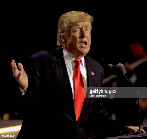View of American real estate developer and presidential candidate Donald Trump at a podium as he addresses the Republican National Convention on its...