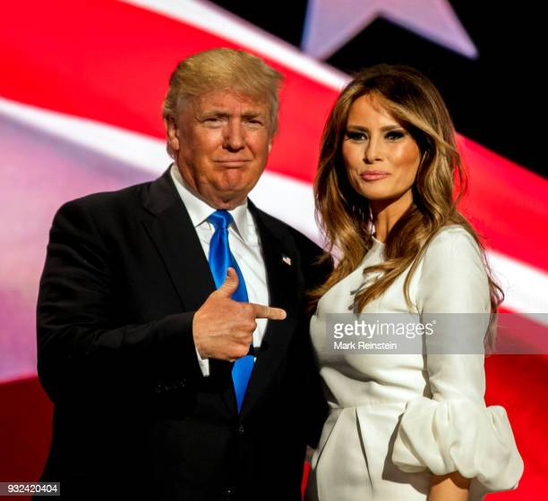 View of American real estate developer and presidential candidate Donald Trump and his wife former model Melania Trump onstage on first night of...