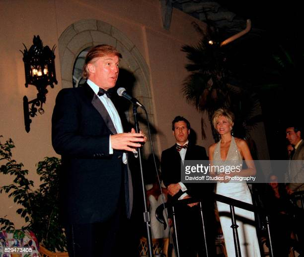 View of American real estate developer Donald Trump on stage during the official opening party of the MaraLago Club Palm Beach Florida April 22 1995...