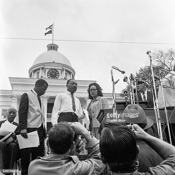 View of American religious and Civil Rights leaders John Lewis and Martin Luther King Jr and his wife Coretta Scott King on the podium before the...