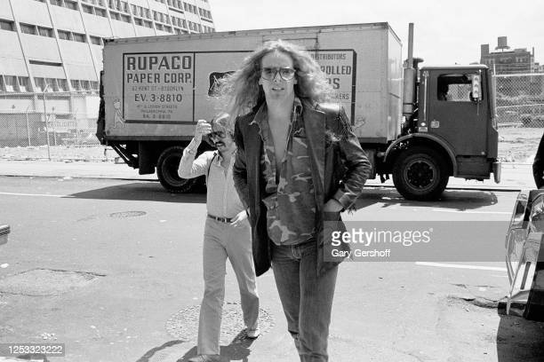 View of American Rock musician Ted Nugent in a parking lot as he arrives for an interview at MTV Studios, New York, New York, June 24, 1982.