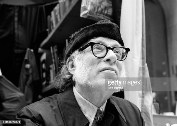 View of American science fiction mystery writer Isaac Asimov as he attends at the 5th Avenue Book Fair New York New York September 20 1987