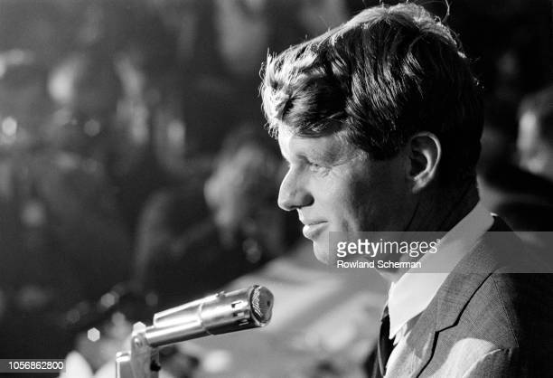 View of American senator Robert F Kennedy as he speaks into a microphone at an unspecifed rally during his campaign for the Democratic Party's...