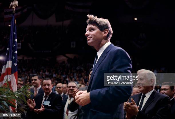 View of American senator Robert F Kennedy as stands to audience applause at an unspecifed rally during his campaign for the Democratic Party's...