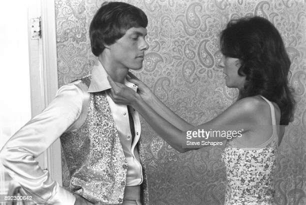 View of American sibling musicians Richard Carpenter and Karen Carpenter as the latter adjusts the former's collar Los Angeles California 1973 The...
