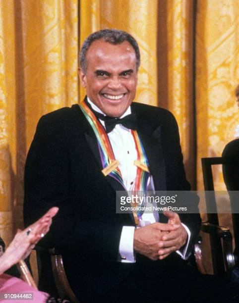 View of American singer and actor Harry Belafonte during a ceremony for 1989 Kennedy Center Honorees in the White House's East Room, Washington DC,...