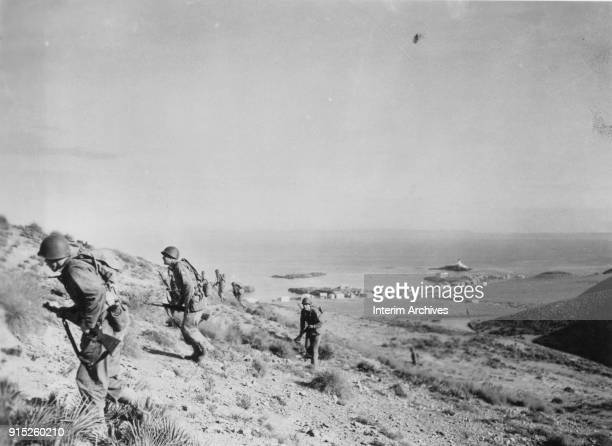 View of American soldiers as they move up a hill, North Africa, December 12, 1942.