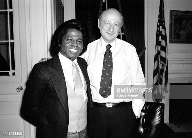 View of American Soul and RB singer James Brown and New York Mayor Ed Koch as they talk together at New York City Hall New York New York January 23...