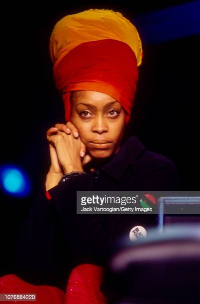 View of American Soul, R&B, and Hiphop musician Erykah Badu as she looks on from upstage during the Rhythm & Blues Foundation's Pioneer Awards at the...