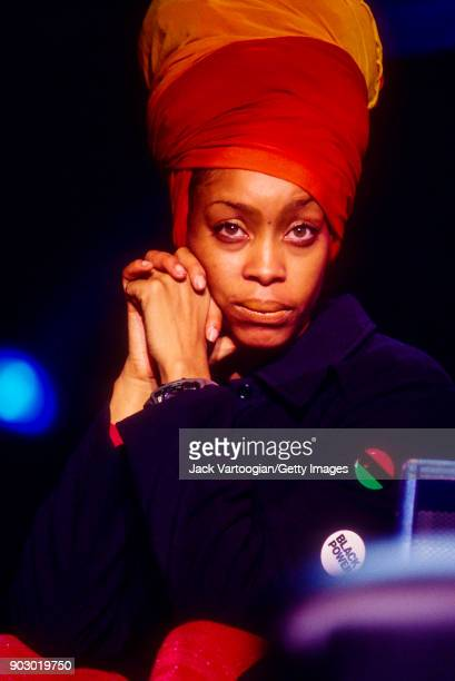 View of American Soul RB and Hiphop musician Erykah Badu as she looks on from upstage during the Rhythm Blues Foundation's Pioneer Awards at the...