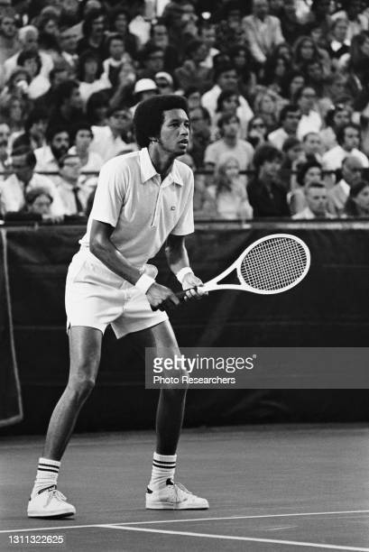 View of American tennis player Arthur Ashe on the court as he competes during the US Pro Championships, Brookline, Massachusetts, 1970s.