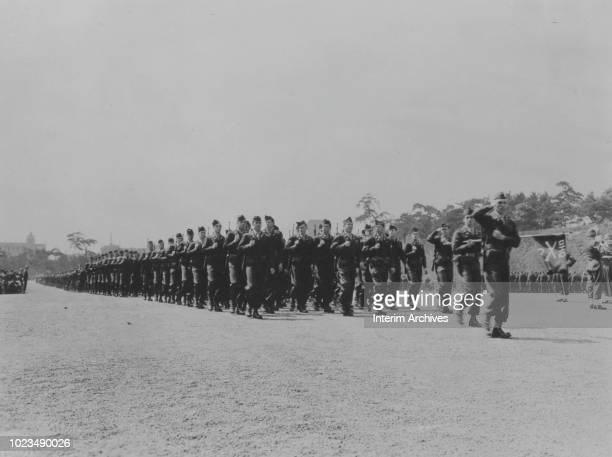 View of American troops as they march past the reviewing stand during Army Day ceremony held at the Emperor's Palace Plaza grounds Tokyo Japan April...