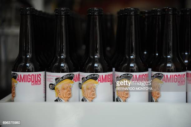 View of Amigous Craft Beer which bottle shows an image of US President Donald Trump wearing a Mariachi costume in Mexico City on June 15 2017 / AFP...