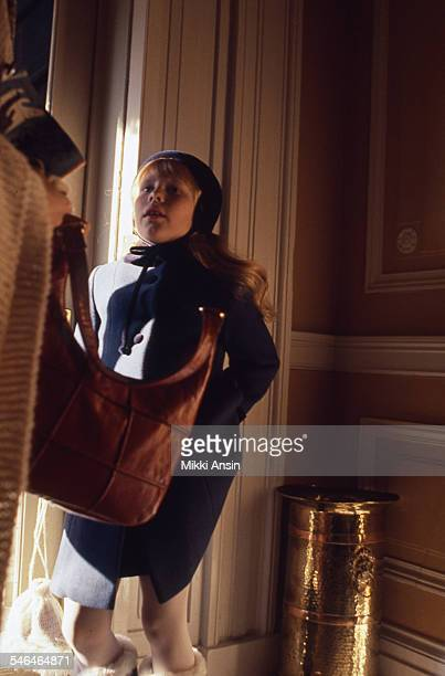 View of Amy Carter daughter of newly inaugurated US President Jimmy Carter as she waits inside the front door of Blair House before her father's...