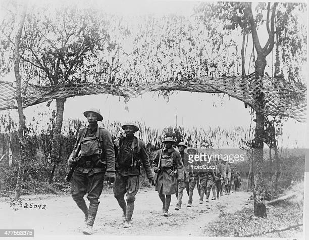 View of an AfricanAmerican unit of US Army Infantry troops as they march during WWI northwest of Verdun France November 5 1918