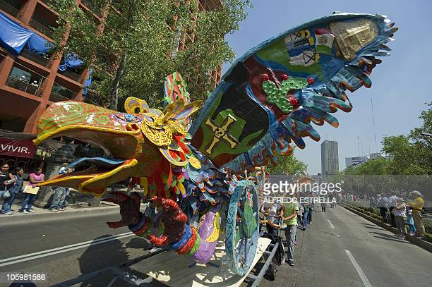 View of an 'Alebrije' during the fourth parade of The Night of the Alebrijes along Reforma Avenue in Mexico City on October 23 2010 The Alebrije is a...