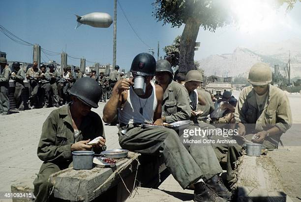 A view of an Allied troops eating outside after the invasion of Sicily 5 days after the campaign called Operation Husky during the World War II in...