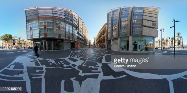 View of an almost empty Corso Vittorio Emanuele with Via Sparano crossroads where a citizen walks the dog on April 22, 2020 in Bari, Italy. Italy...
