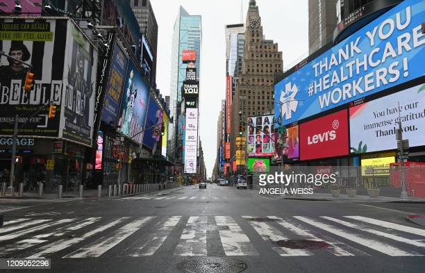 View of an almost empty Time Square on April 03 2020 in New York In New York the epicenter of the US outbreak Mayor Bill de Blasio urged residents to...